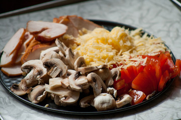for pizza lovers . photos of cooking delicious, thin pizza on lavash with smoked chicken, mushrooms, tomatoes, and cheese