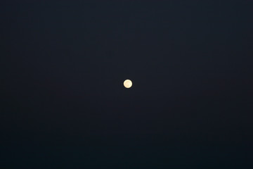 The moon in the dark night in the clear sky