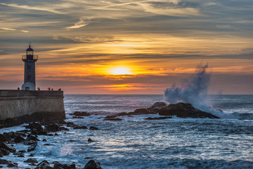 Sunset over Atlantic Ocean and Felgueiras Lighthouse in Porto city, Portugal