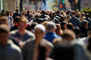 Crowd of people walking street in city