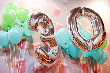 Silver balloons with ribbons - Number 30. Party decoration, anniversary sign for happy holiday, celebration, birthday, carnival. Metallic design balloon.
