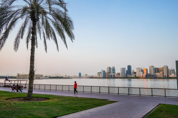 Sharjah. Summer 2016. Evening cityscape with the Persian Gulf and city architecture.