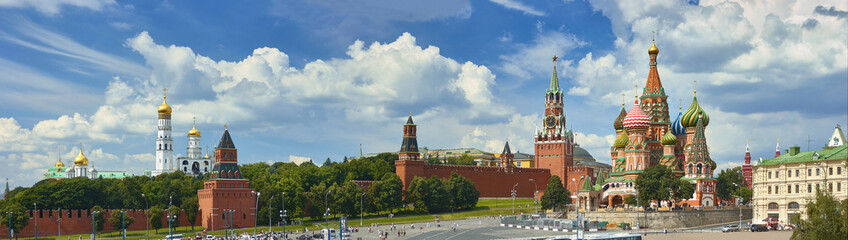 Tuinposter Moskou Panoramic view on Moscow Red Square, Kremlin towers, stars and Clock Kuranti, Saint Basil's Cathedral church Ivan bell tower. Panorama from hotel Russia. Moscow holidays vacation tours Putin residence