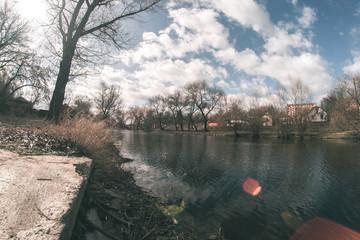 Spring landscape near the fisheye river.