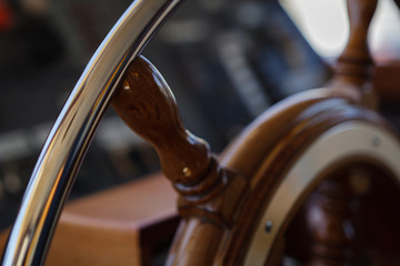 Steering wheel on the bridge of the yacht