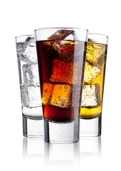 Glasses of energy drink cola and  sparkling water