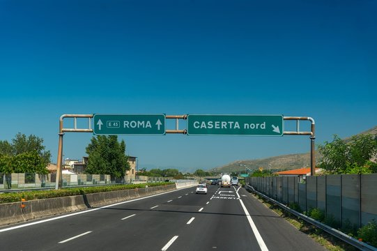 Highway with blue sky near Roma and Caserta in Italy
