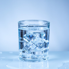 ice cube in glass of water