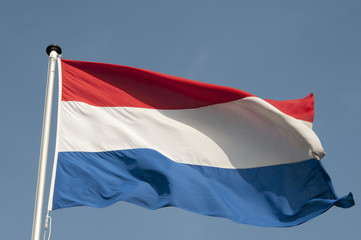 The Dutch red and white flag blowing in the wind