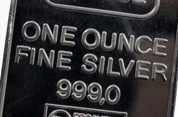 The surface of minted silver bar in one troy ounce. The texture of the surface of the silver ingot.