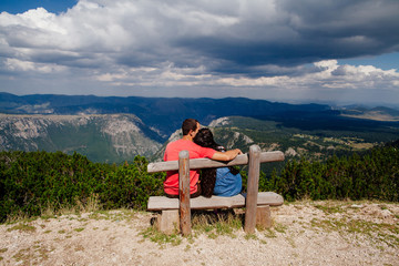 couple travel and relax in mountains
