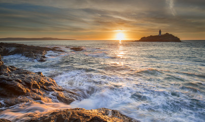 Sunset at Godrevy lighthouse with sea