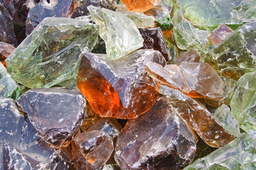 A pile of pieces of colored glass melted. Background, texture