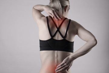 Woman suffering from back pain . Sports exercising injury.