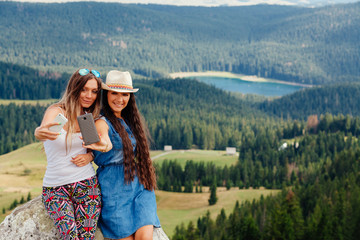 young Girls travel and taking Selfie photo