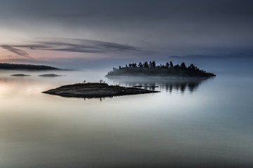 Islands of stone. The island is in a fog. Karelia.