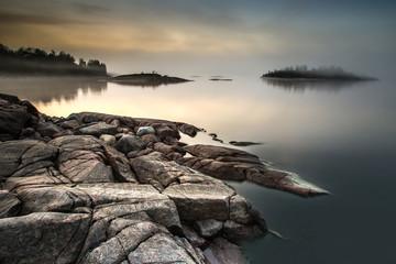 The island is in a fog. Karelia. Fog on the water.Early morning on the beach. Fog. Ladoga lake....