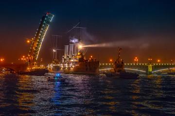 Cruiser Aurora. Cruiser Aurora goes along the Neva River. St. Petersburg.