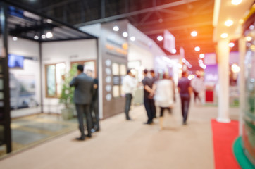 abstract blurred people in event hall for use as business background