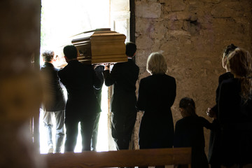 Family following coffin from church