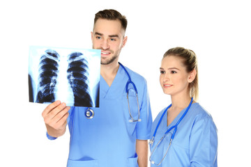 Doctor and medical assistant with x-ray image on white background