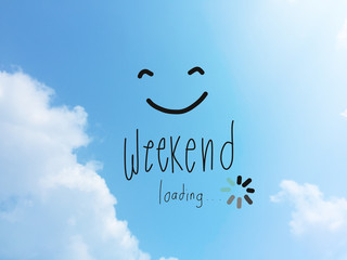 Weekend loading word and smile face on blue sky