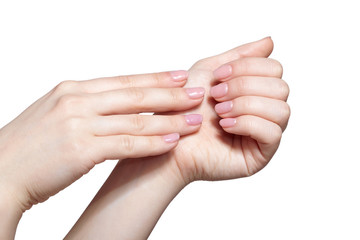 Female hands with woman's professional natursl pink nails manicure on white