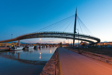 Pescara, Italy - The Ponte del Mare bridge at the dusk, in the canal and port of Pescara city,...