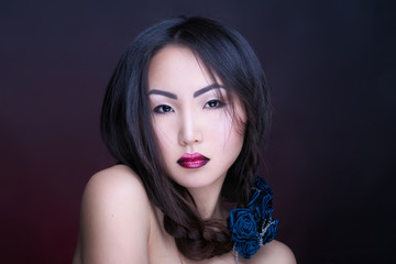 Portrait of the beautiful asian girl with creative art makeup