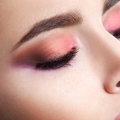 Closeup of beautiful woman eye with makeup, closed eyes.
