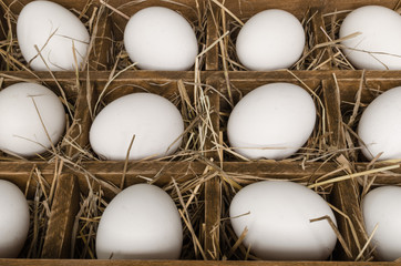 Wooden box with chicken eggs