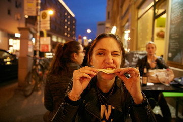 A girl eating at night in a Berlin restaurant