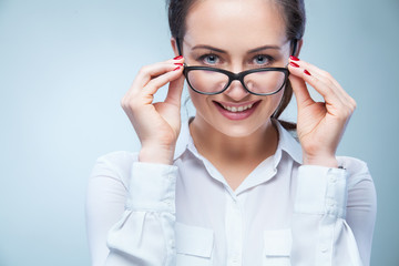 woman with glasses on light background