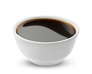 Soy sauce in bowl isolated on white background, with clipping path, one of the collection of various sauces