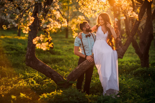 Beautiful bride and groom at sunset in the Park. A spring wedding.