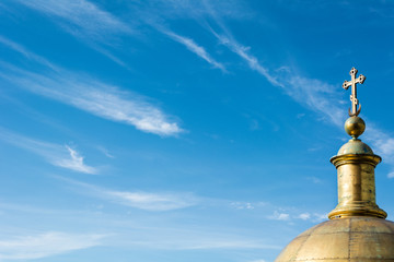golden dome of the Christian cathedral on a background of the beautiful sky