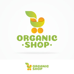 Organic shop logo set consisting of shopping cart and leaf yellow green color isolated on white background use for farm fresh shop, natural product market, vegan food store etc. Vector Illustration