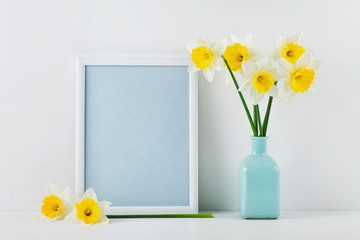 Mockup of picture frame decorated daffodil flowers in vase with clean space for text your blogging and greeting for mother day.