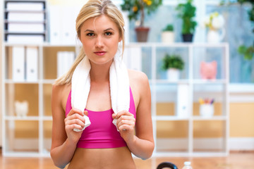 Young fit healthy woman with towel