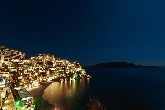 Hotel complex for rich people Dukley Gardens in Budva, Montenegro. Night photo at the full moon, starry sky.