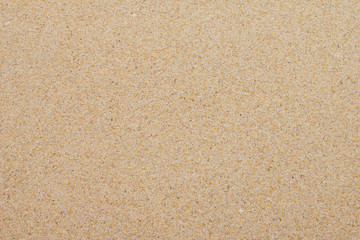 Wall Mural - closeup of sand background pattern of a beach in the summer