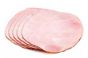 Thin slices of ham on white background.