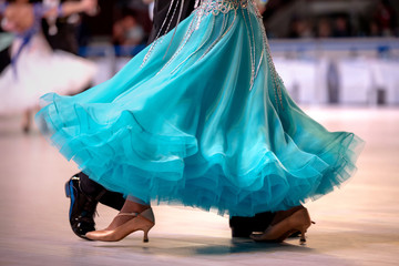turquoise dress female dancer championship in ballroom dancing