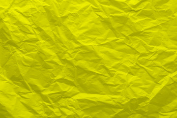Background of crumpled yellow paper