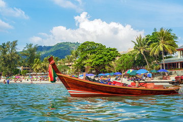 Traditional Thai long boat on Kata beach - one of the best beaches in Phuket, Thailand