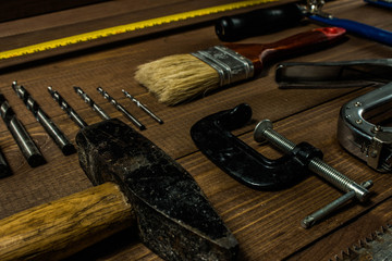 Set of hand tools on a wooden table