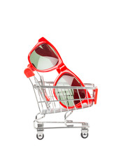Red sun glasses in shopping cart