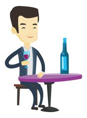 Man drinking wine at restaurant.
