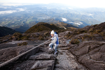 The Woman is hiking on Kinabarull mountain