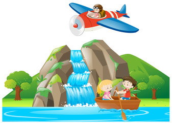 Scene with kids rowing boat